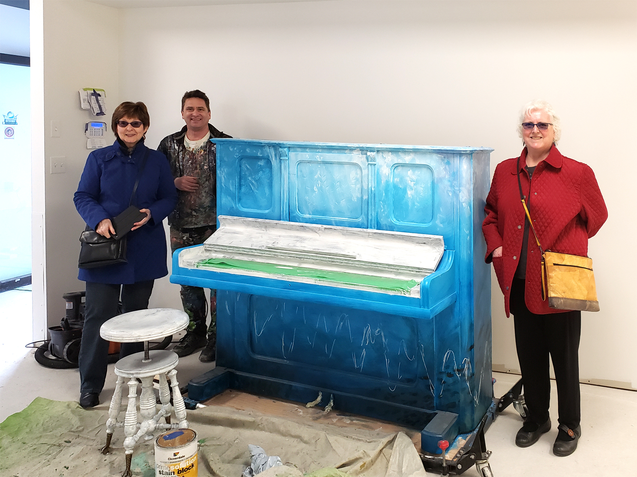 Shannon Bellamy (VP, Festival of Murals Society), Kris Friesen and Peggy Grigor, during construction (Feb. 22, 2020).