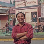 Arthur Cheng with Star Works Novelty Works mural in the background